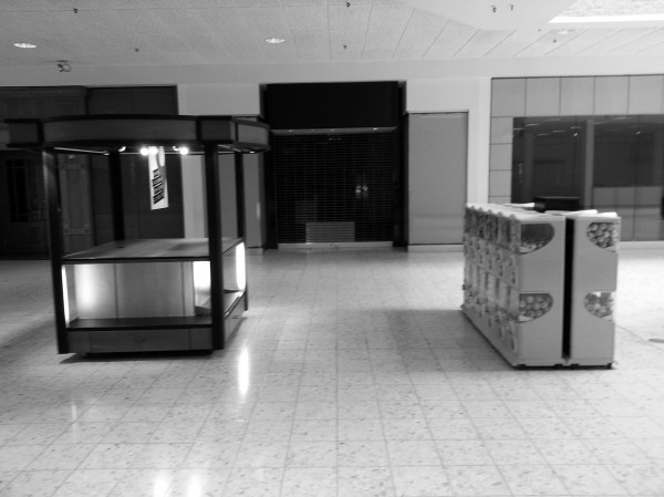 Century III shopping mall common area with empty kiosk and candy machines