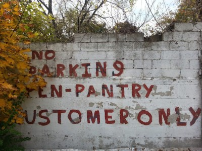 """No Parking Open-Pantry Customer Only"" painted on wall in Lincoln"