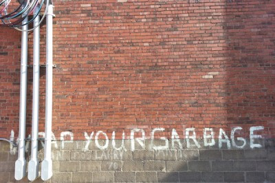 """Wrap Your Garbage"" painted on side of building in Lawrenceville"