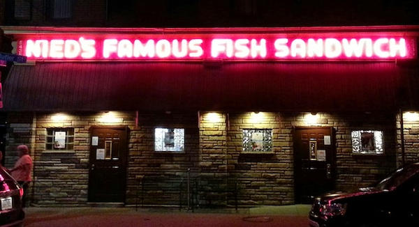 Nied's Famous Fish Sandwich bar/restaurant with glowing neon sign at night