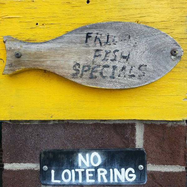 "Handmade wooden sign reading ""Fried Fish Specials"""