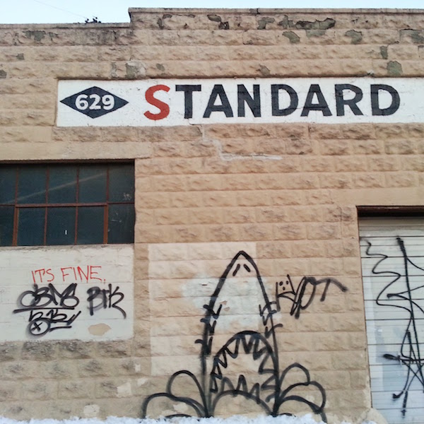 """Graffiti on garage wall similar to the """"Jaws"""" movie poster"""