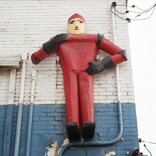 Figure of a man created from steel parts on wall of Mars Builders Supply, McKeesport, PA