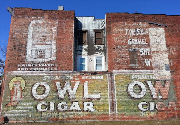 Painted wall advertisement for Owl Cigar