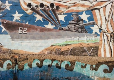 Detail of mural on the Bloomfield V.F.W. showing battleship with exaggerated cannons
