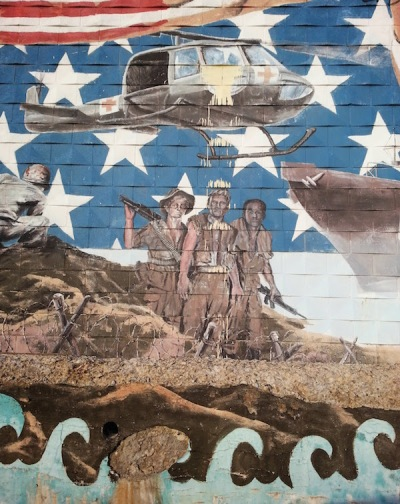 Detail of mural on the Bloomfield V.F.W. showing Vietnam soldiers and helicopter