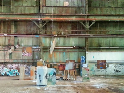 industrial warehouse interior with paint slingshot targets