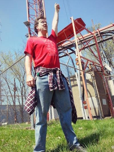 Man celebrating reaching Pittsburgh's highpoint