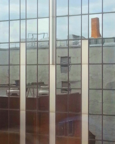 University of Pittsburgh building reflected in glass windows