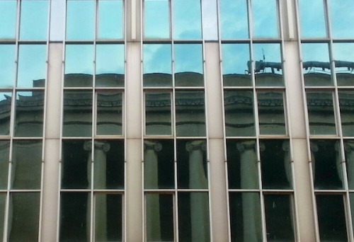 Mellon Institute in Pittsburgh reflected in glass windows