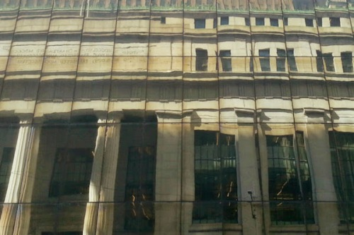 Reflection of the former Mellon National Bank, Downtown Pittsburgh in mirrored glass windows