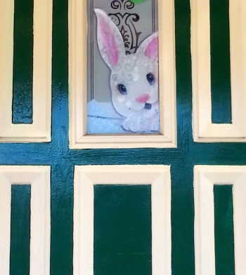 Easter bunny in door window