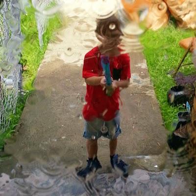 boy holding a super-soaker squirt gun