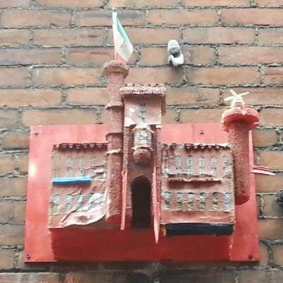 homemade model of a castle mounted to a brick wall