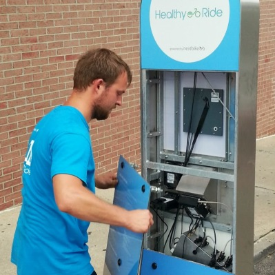 NextBike employee restarting a Healthy Ride station, Pittsburgh, Pa.