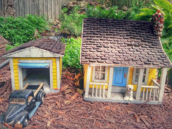 model house, garage, and old pickup truck