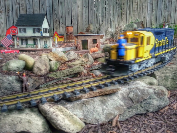 backyard train set with model buildings