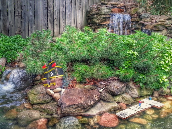 garden with waterfalls and model pirate ship and dock