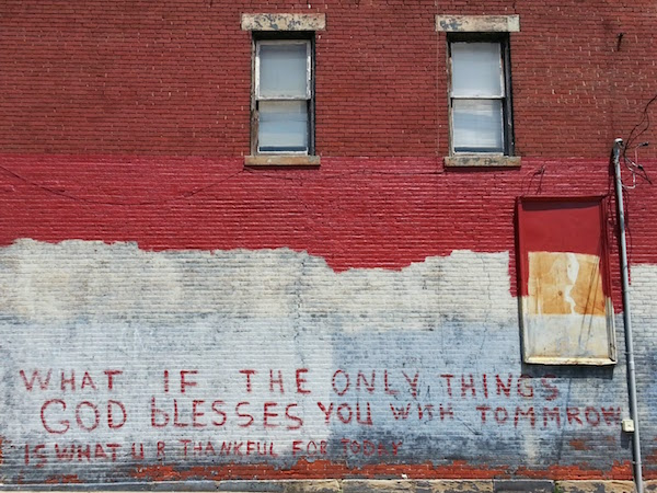 "Brick wall with graffiti reading ""What if the only things God blesses you with tommrow is what u r thankful for today"""