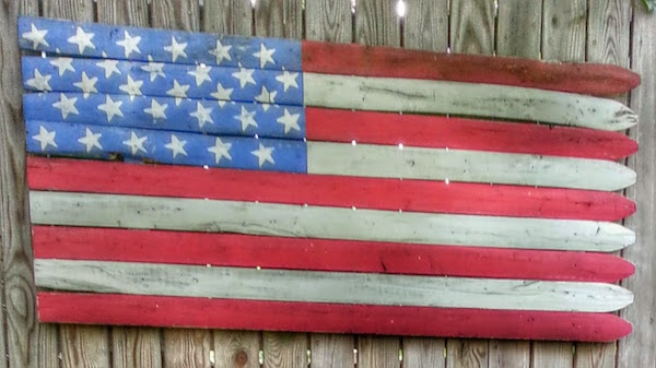 American flag made out of wooden fence
