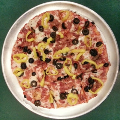 "Sir Pizza 10"" pizza with black olives and banana peppers"