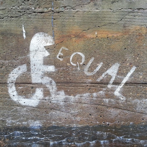 """stencil graffiti of figure in wheelchair with the word """"equal"""", Pittsburgh, Pa."""