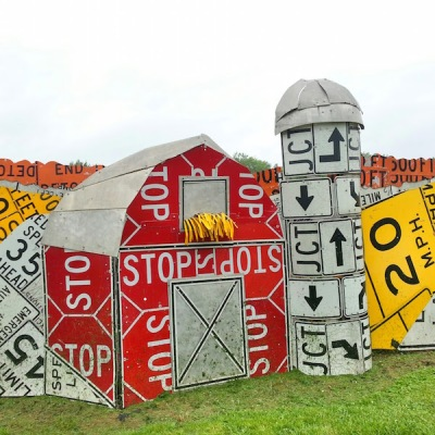 Meadville PennDOT sign sculpture fence of barn and silo