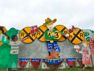 Meadville PennDOT sign sculpture fence of singing cowboy on stage