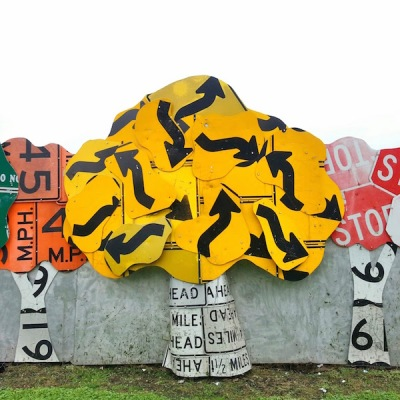 Meadville PennDOT sign sculpture fence of trees