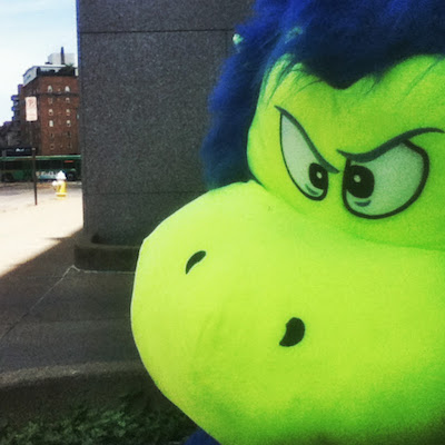 stuffed monster toy on street