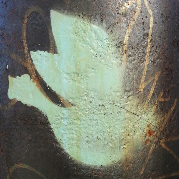 stencil graffiti of a dove on a street pole, Pittsburgh, Pa.