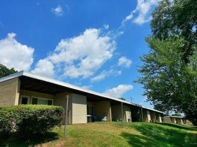 Aluminum City Terrace single-story one-bedroom block