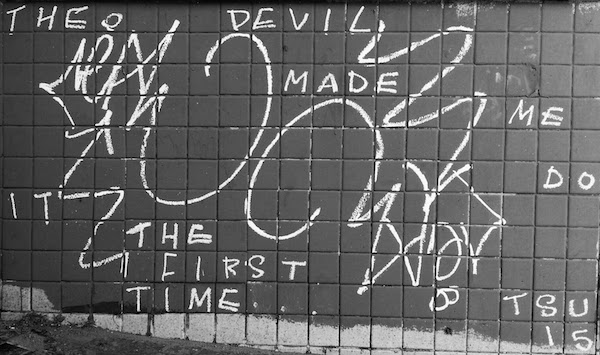 "Graffiti on tile wall reading ""The Devil made me do it the first time ..."", Pittsburgh, PA"