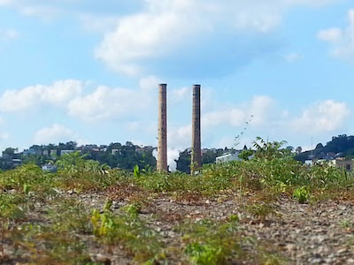Heinz plant smokestacks seen over a mound of gravel in the Strip District, Pittsburgh, PA
