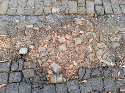 Damaged section of Roslyn Place's wooden street