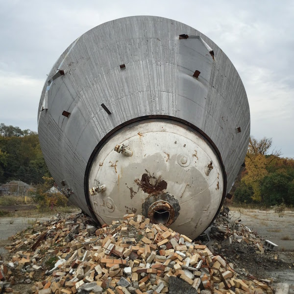 Westinghouse atom smasher on pile of rubble, Forest Hills, PA