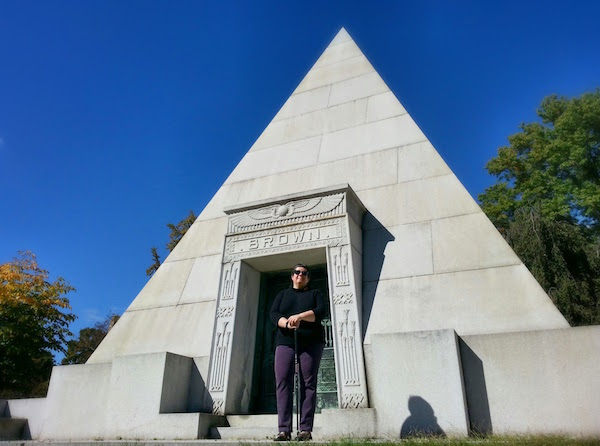 Jennie Benford, Homewood Cemetery archivist, in front of Brown mausoleum