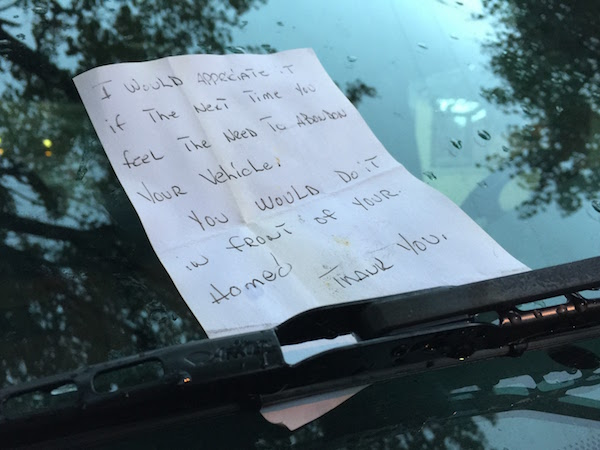"""Note left on car's windshield reading """"I would appreciate it if the next time you feel the need to abandon your vehicle you would do it in front of your home. Thank you."""""""