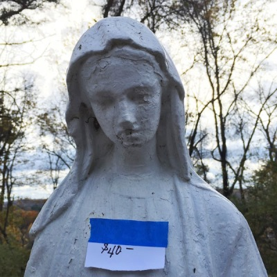 lawn ornament of Mary with $40 hand-written price tag
