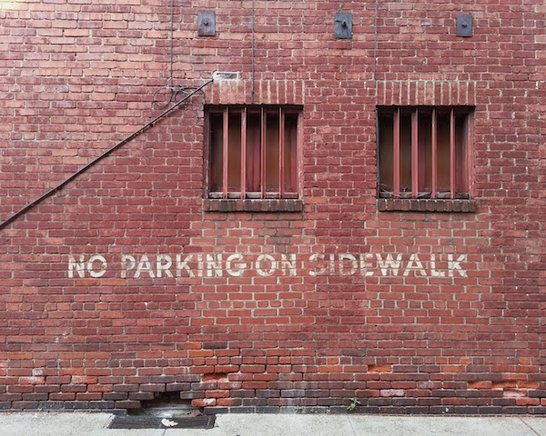 brick walk with no parking message painted