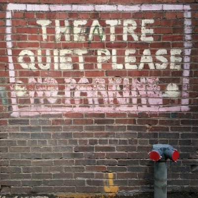 """brick wall with message """"Theatre. Quiet please. No parking."""" painted, Downtown Pittsburgh"""