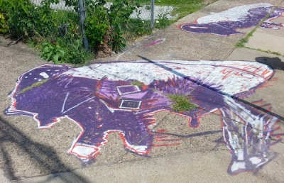 sidewalk painting of purple and white buffalos