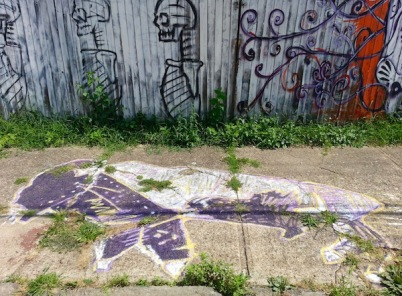 sidewalk painting of purple and white buffalo with painted fence