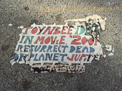 "Toynbee Tile reading ""Toynbee Idea in movie '2001' resurrect dead on planet Jupiter"""