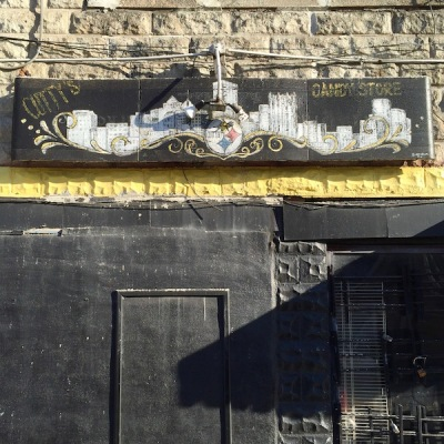 "Sign for Cutty's Candy Store that includes the Pittsburgh skyline and a version of the Steelers logo with the word ""Cutty"" added"