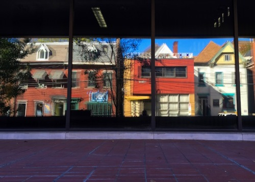 reflection of small shops on Craig Street in large glass windows, Pittsburgh, PA