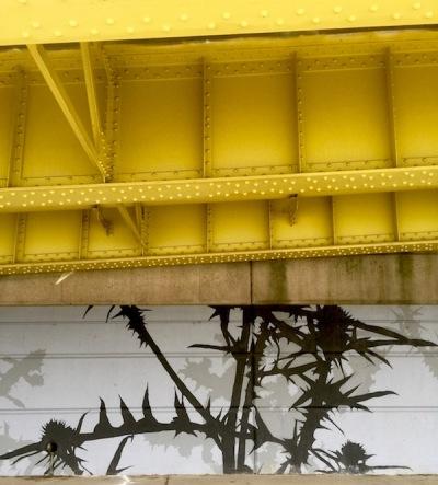 Adjutant mural of Canada thistle under Fort Duquesne Bridge ramp, Pittsburgh, PA