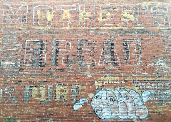 layers of ghost signs on brick wall, Glassport, PA