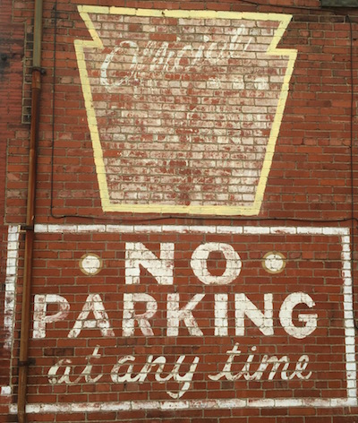 """faded painting on brick wall reading """"No Parking at any time"""", Glassport, PA"""