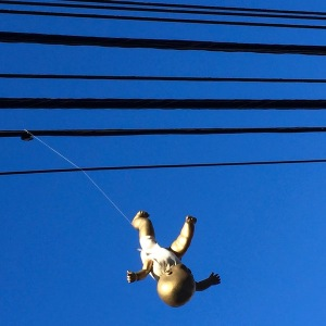 Golden baby hanging from power lines, Pittsburgh, PA